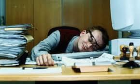 Man sleeping at his desk 5