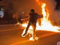 Protestor catches fire
