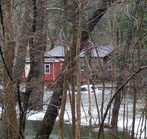 House_and_car_in_river